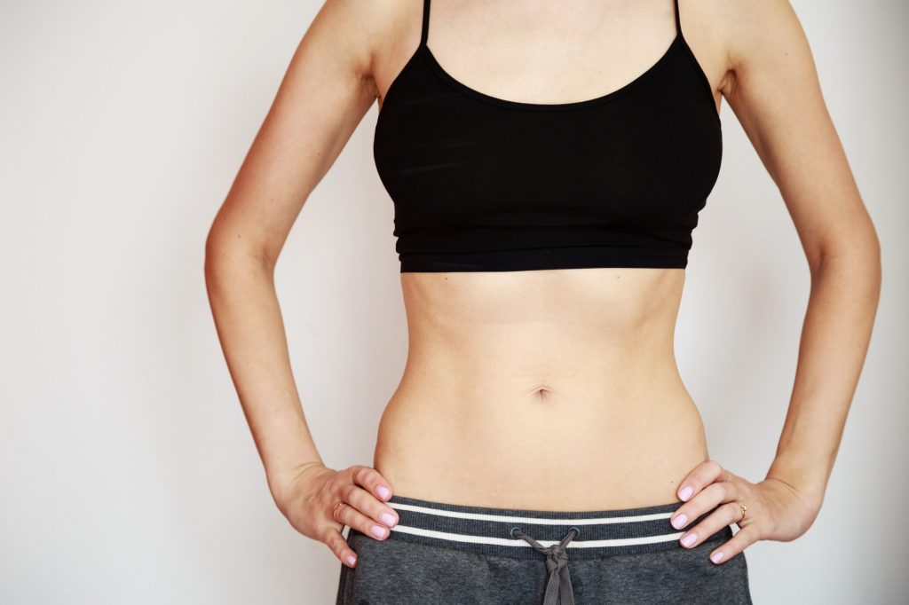 Slim body of young woman. Sport, fitness, exercise, workout, diet and healthy lifestyle